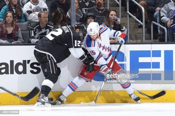 Marian Gaborik of the Los Angeles Kings skates against Derek Dorsett of the New York Rangers in Game One of the 2014 NHL Stanley Cup Final at Staples...