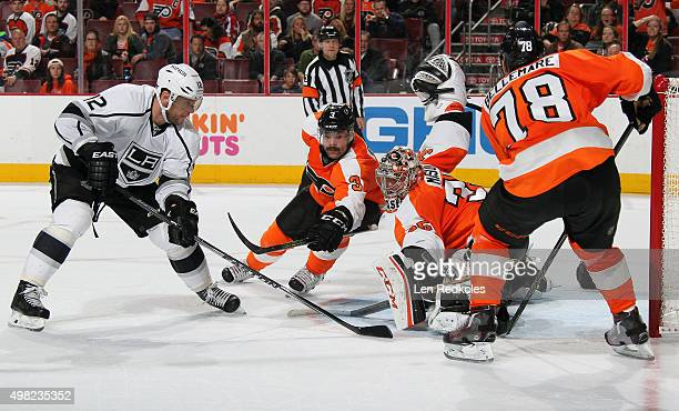 Marian Gaborik of the Los Angeles Kings takes an overtime shot on goal against Steve Mason Radko Gudas and PierreEdouard Bellemare of the...