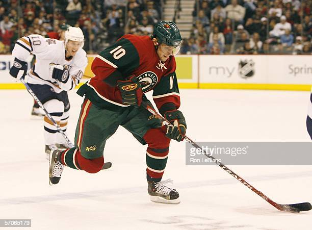 Marian Gaborik of the Minnesota Wild carries the puck up the ice while pursued by Shawn Horcoff of the Emdmonton Oilers during a game March 12, 2006...