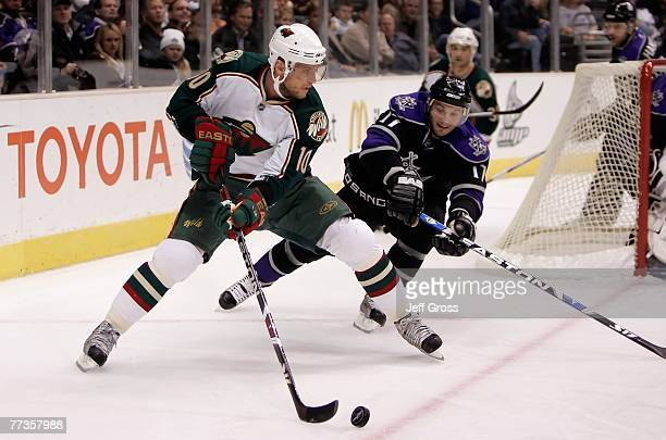 Marian Gaborik of the Minnesota Wild is pursued by Lubomir Visnovsky of the Los Angeles Kings in the first period at the Staples Center on October 16...