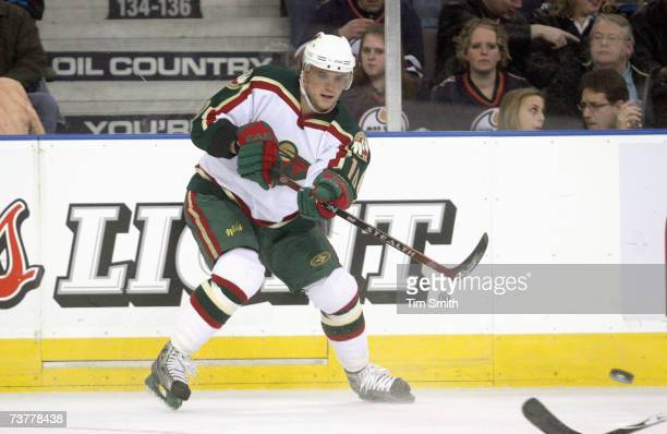 Marian Gaborik of the Minnesota Wild passes the puck against the Edmonton Oilers at Rexall Place on March 15 in Edmonton Alberta Canada