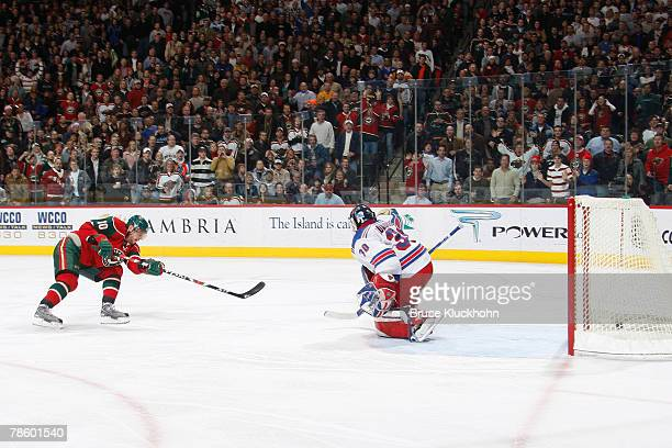 Marian Gaborik of the Minnesota Wild scores his fifth goal of the game against Henrik Lundqvist of the New York Rangers during the game at Xcel...