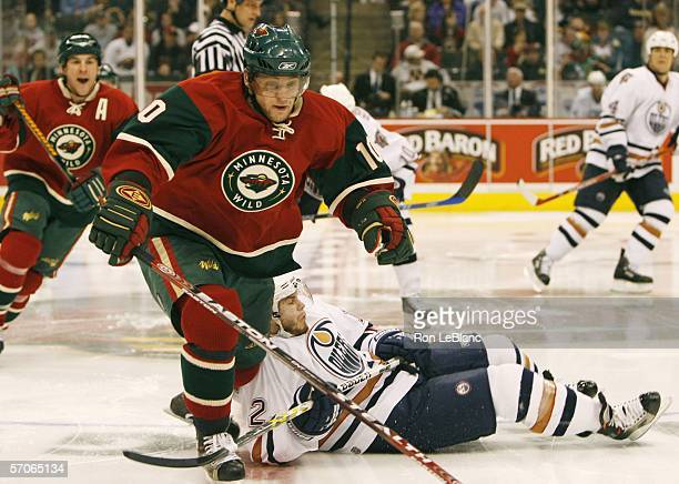 Marian Gaborik of the Minnesota Wild sends Sergei Samsonov of the Emdmonton Oilers to the ice during a game on March 12 2006 at the Xcel Energy...