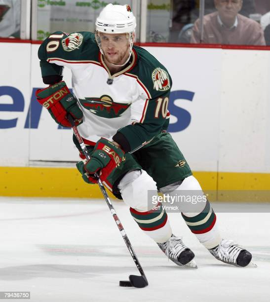 Marian Gaborik of the Minnesota Wild skates up ice with the puck during their game against the Vancouver Canucks at General Motors Place on January...