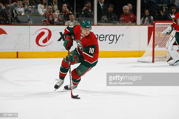 Marian Gaborik of the Minnesota Wild skates with the puck against the Calgary Flames during the game at Xcel Energy Center on March 27, 2007 in Saint...