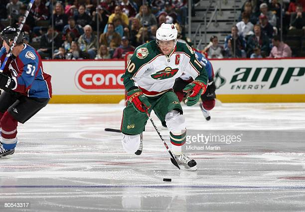 Marian Gaborik of the Minnesota Wild skates with the puck against the Colorado Avalanche at the Pepsi Center on April 6 2008 in Denver Colorado