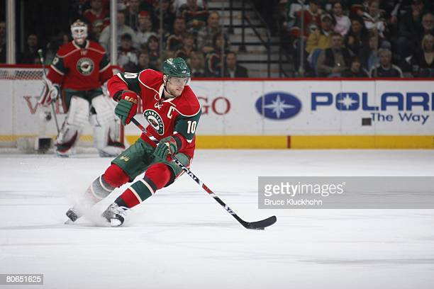 Marian Gaborik of the Minnesota Wild skates with the puck against the Colorado Avalanche during Game One of the Western Conference QuarterFinal of...