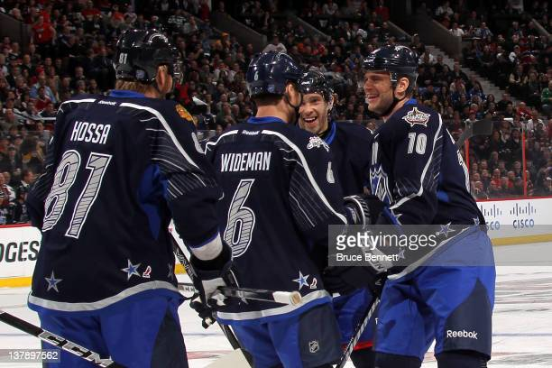 Marian Gaborik of the New York Rangers and Team Chara celebrates with his teammates after scoring a goal in the first period against Team Alfredsson...
