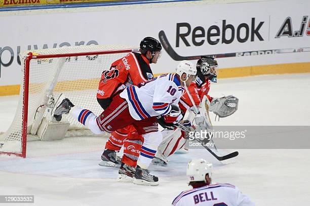 Marian Gaborik of the New York Rangers battles for position in front of the net with Timo Helblng of EV Zug at the Bossard Arena during the 2011 NHL...