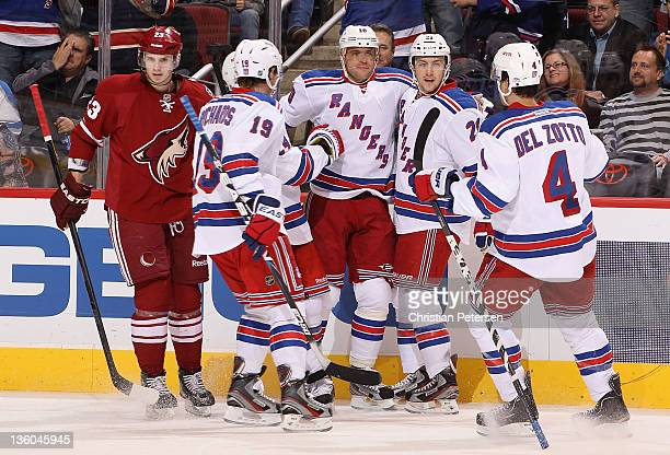 Marian Gaborik of the New York Rangers celebrates with Brad Richards Derek Stepan and Michael Del Zotto after Gaborik scored a first period power...