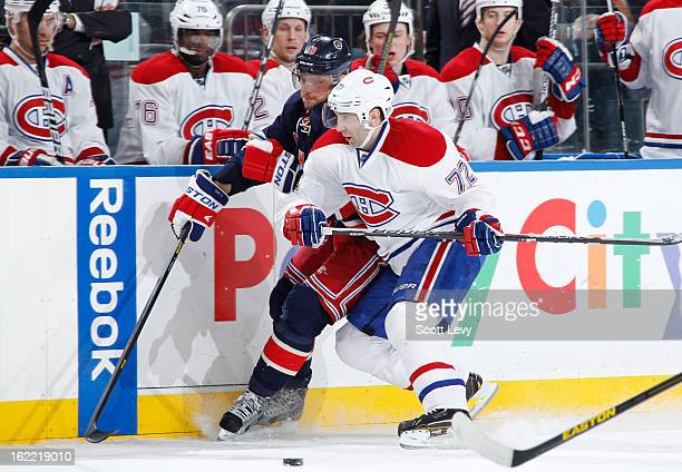 Marian Gaborik of the New York Rangers races for control of the puck against Erik Cole of the Montreal Canadiens at Madison Square Garden on February...