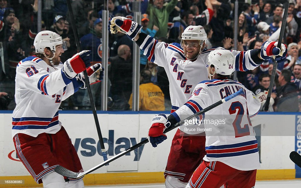 Marian Gaborik #10 of the New York Rangers (C) scores a powerplay goal at 42 seconds of overtime to defeat the New York Islanders 2-1 and is joined by Rick Nash #61 (L) and Ryan Callahan #24 (R) at the Nassau Veterans Memorial Coliseum on March 7, 2013 in Uniondale, New York.