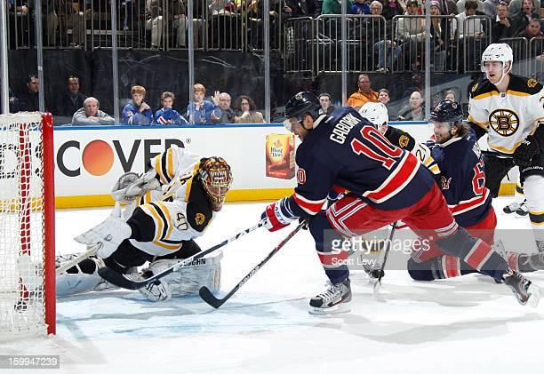 Marian Gaborik of the New York Rangers scores his first goal of the season against goaltender Tuukka Rask of the Boston Bruins at Madison Square...