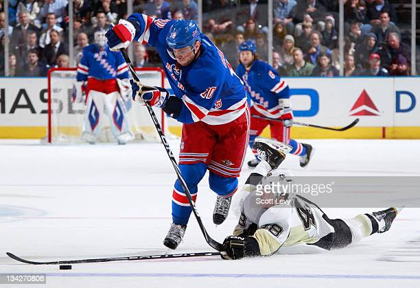 Marian Gaborik of the New York Rangers skates in the first period against Tyler Kennedy of the Pittsburgh Penguins at Madison Square Garden on...
