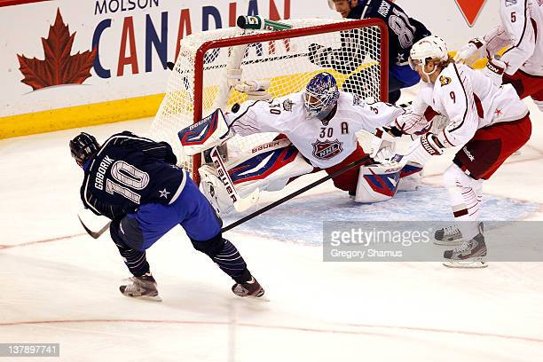 Marian Gaborik of the New York Rangers Team Chara scores his second goal in the first period against Henrik Lundqvist of the New York Rangers and...