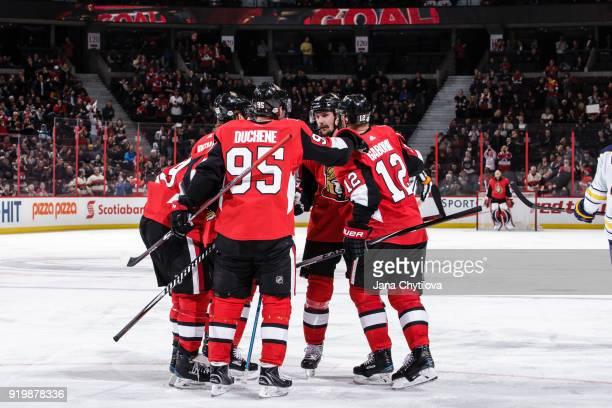 Marian Gaborik of the Ottawa Senators celebrates his third period goal against the Buffalo Sabres with team mates Matt Duchene and Erik Karlsson at...