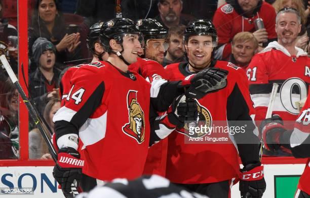 Marian Gaborik of the Ottawa Senators celebrates his third period goal against the Dallas Stars with teammates Alexandre Burrows Cody Ceci and Ryan...