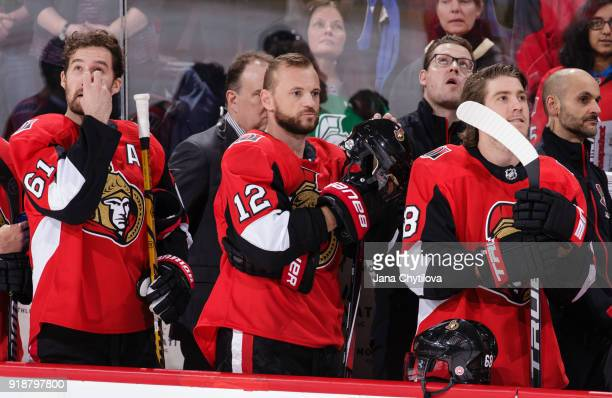 Marian GaborikMark Stone and Mike Hoffman of the Ottawa Senators standing during the singing of the national anthems prior to a game against the...
