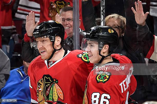 Marian Hossa and Teuvo Teravainen of the Chicago Blackhawks celebrate after Teravainen scored against the Edmonton Oilers in the third period of the...