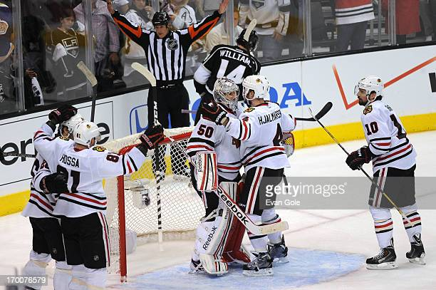 Marian Hossa Corey Crawford Niklas Hjalmarsson and Patrick Sharp of the Chicago Blackhawks celebrate against the Los Angeles Kings in Game Four of...