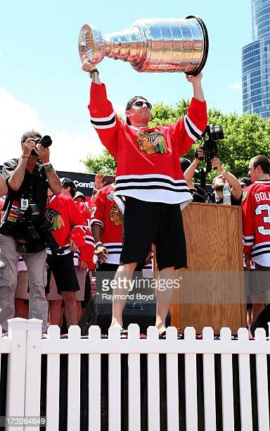 Marian Hossa forward for the Chicago Blackhawks raises the Stanley Cup Trophy during the Chicago Blackhawks' 2013 Stanley Cup Championship rally at...