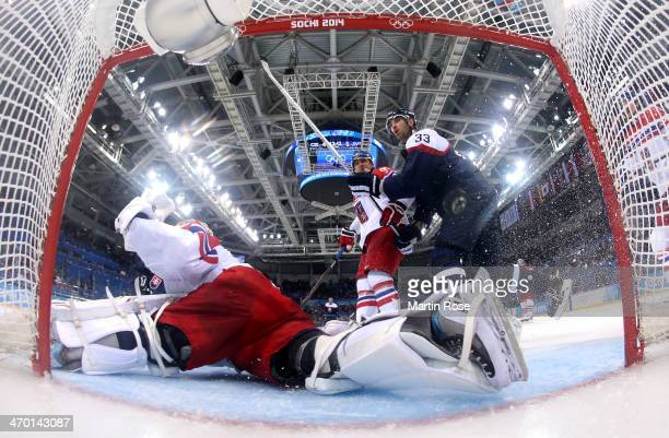 Marian Hossa of Slovakia shoots and scores against Ondrej Pavelec of Czech Republic in the third period during the Men's Qualification Playoff Game...
