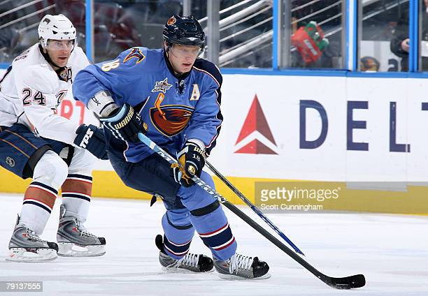 Marian Hossa of the Atlanta Thrashers carries the puck against Steve Staios of the Edmonton Oilers at Philips Arena on January 20, 2008 in Atlanta,...