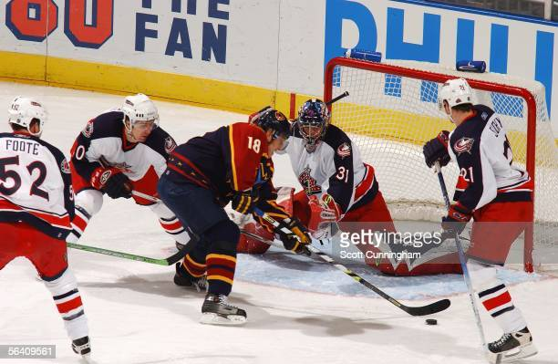 Marian Hossa of the Atlanta Thrashers shoots against Pascal Leclaire of the Columbus Blue Jackets on December 9, 2005 at Philips Arena in Atlanta,...