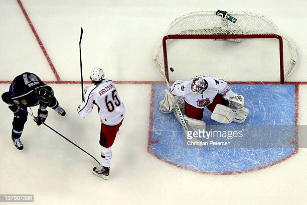 Marian Hossa of the Chicago Blackhawks and Team Chara scores a goal in the third period against Brian Elliott of the St Louis Blues and Team...