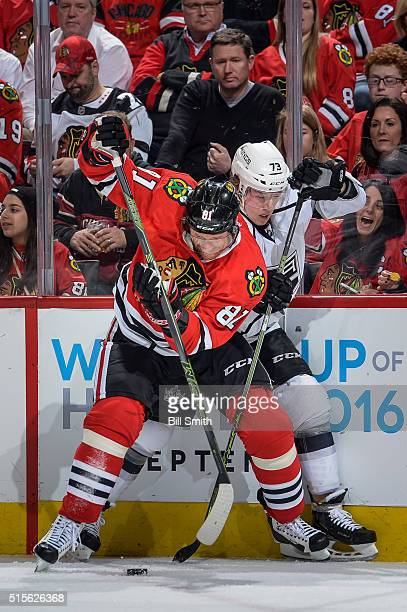Marian Hossa of the Chicago Blackhawks and Tyler Toffoli of the Los Angeles Kings battle for the puck in the first period of the NHL game at the...