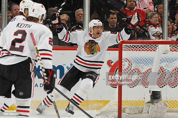 Marian Hossa of the Chicago Blackhawks celebrates after assisting on a goal against the Minnesota Wild in Game Four of the Western Conference...
