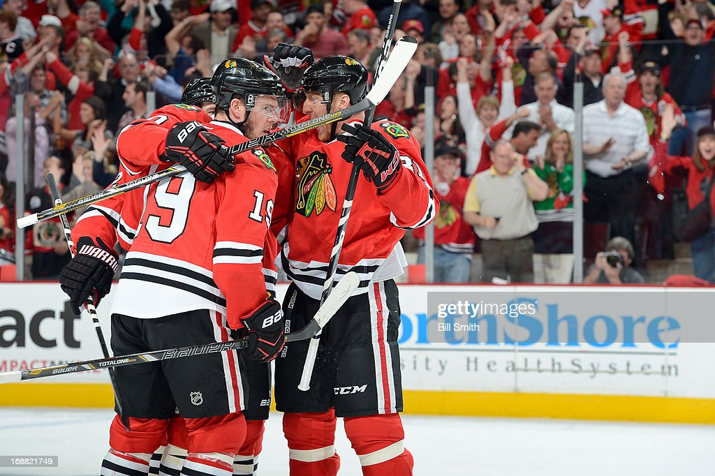 Marian Hossa #81 of the Chicago Blackhawks celebrates with teammates in Game One of the Western Conference Semifinals against the Detroit Red Wings during the 2013 Stanley Cup Playoffs at the United Center on May 15, 2013 in Chicago, Illinois.