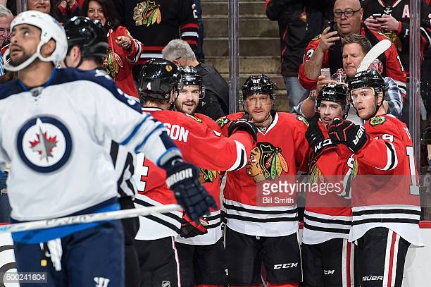 Marian Hossa of the Chicago Blackhawks celebrates with teammates including Brent Seabrook Teuvo Teravainen and Jonathan Toews after scoring against...