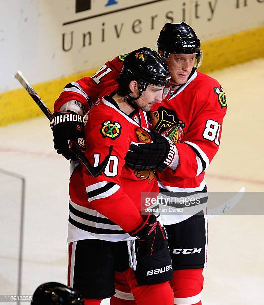 Marian Hossa of the Chicago Blackhawks congratulates teammate Patrick Sharp after Sharp scored his second goal of the game against the Vancouver...