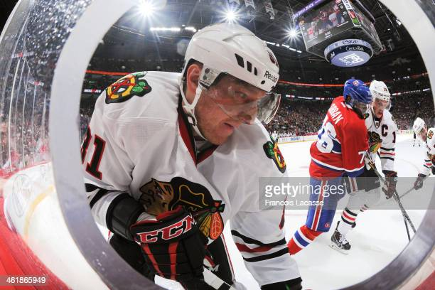Marian Hossa of the Chicago Blackhawks controls the puck while PK Subban of the Montreal Canadiens challenges Jonathan Toews during the NHL game on...