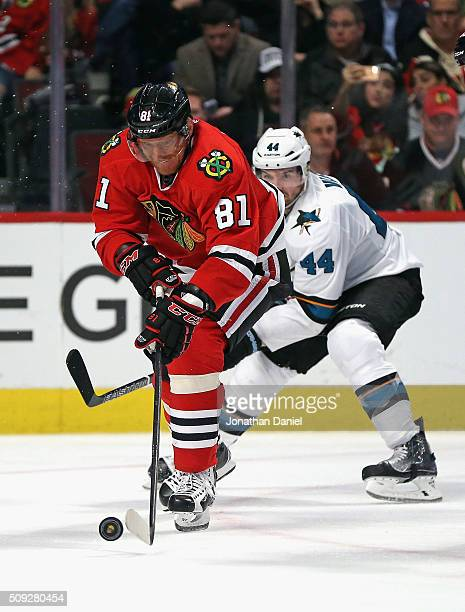 Marian Hossa of the Chicago Blackhawks gets off a shot under pressure from MarcEdouard Vlasic of the San Jose Sharks at the United Center on February...