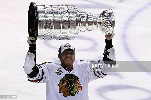 Marian Hossa of the Chicago Blackhawks hoists the Stanley Cup after teammate Patrick Kane scored the gamewinning goal in overtime to defeat the...