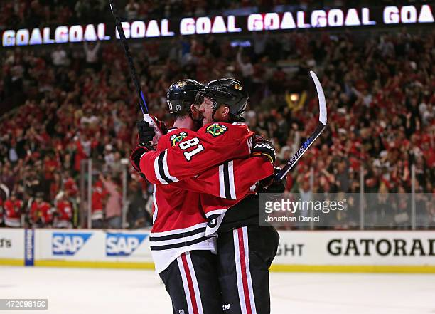 Marian Hossa of the Chicago Blackhawks hugs Jonathan Toews after Toews scored a second period goal against the Minnesota Wild in Game Two of the...