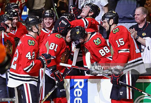 Marian Hossa of the Chicago Blackhawks is mobbed by teammates including Gustav Forsling Jonathan Toews Patrick Kane and Artem Anisimov after scoring...