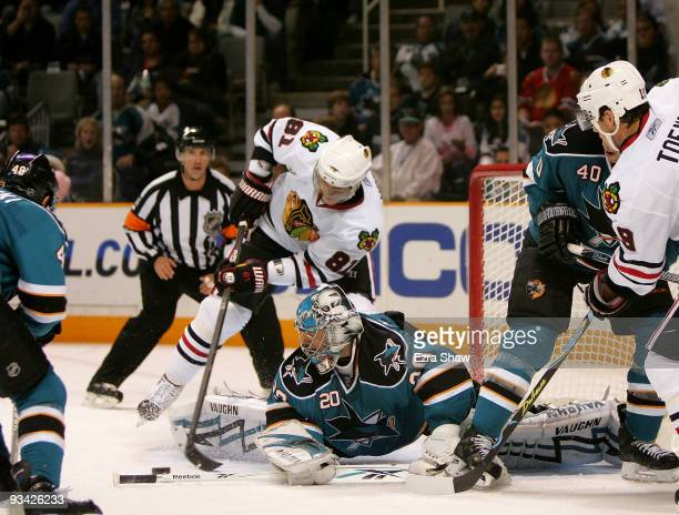 Marian Hossa of the Chicago Blackhawks is stopped by goalie Evgeni Nabokov of the San Jose Sharks during their game at HP Pavilion on November 25,...