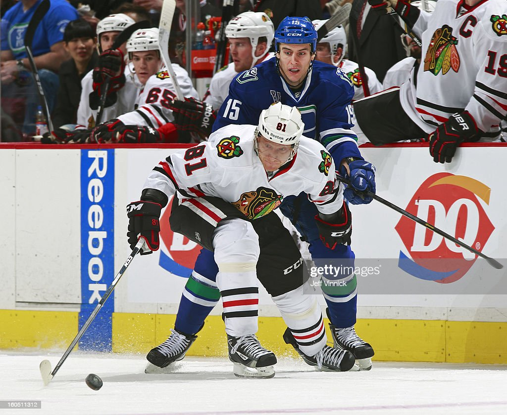 Marian Hossa #81 of the Chicago Blackhawks pulls away from Aaron Volpatti #15 of the Vancouver Canucks during their NHL game at Rogers Arena February 1, 2013 in Vancouver, British Columbia, Canada. Vancouver won 2-1 in a shootout.