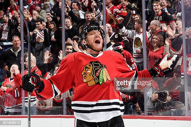 Marian Hossa of the Chicago Blackhawks reacts after assisting in a goal against the Edmonton Oilers in the first period of the NHL game at the United...