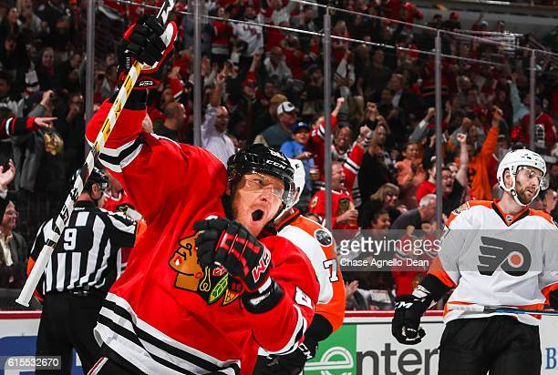 Marian Hossa of the Chicago Blackhawks reacts after scoring his 500th goal as Andrew MacDonald of the Philadelphia Flyers stands behind in the second...