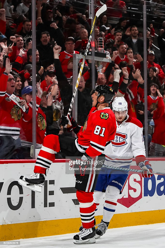 Marian Hossa #81 of the Chicago Blackhawks reacts in front of Nathan Beaulieu #28 of the Montreal Canadiens after scoring in the second period at the United Center on November 13, 2016 in Chicago, Illinois.