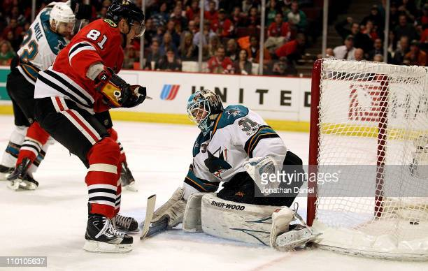 Marian Hossa of the Chicago Blackhawks scores a goal against Antti Niemi of the San Jose Sharks at the United Center on March 14 2011 in Chicago...