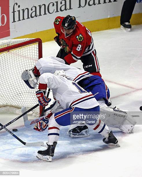 Marian Hossa of the Chicago Blackhawks scores a goal in the second period against Ben Scrivens and Torrey Mitchell of the Montreal Canadiens at the...