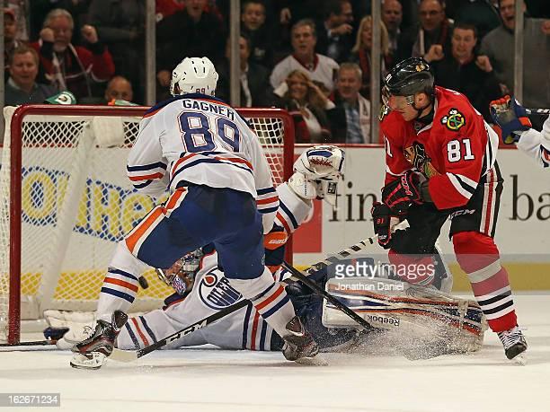 Marian Hossa of the Chicago Blackhawks scores the gamewinning goal against Nikolai Khabublin of the Edmonton Oilers as Sam Gagner defends at the...