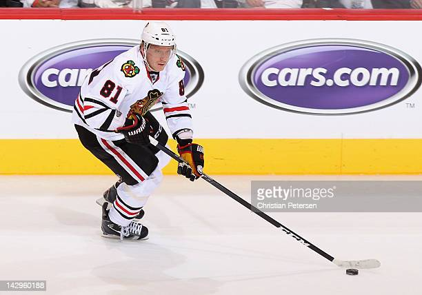 Marian Hossa of the Chicago Blackhawks skates with the puck in Game One of the Western Conference Quarterfinals against the Phoenix Coyotes during...