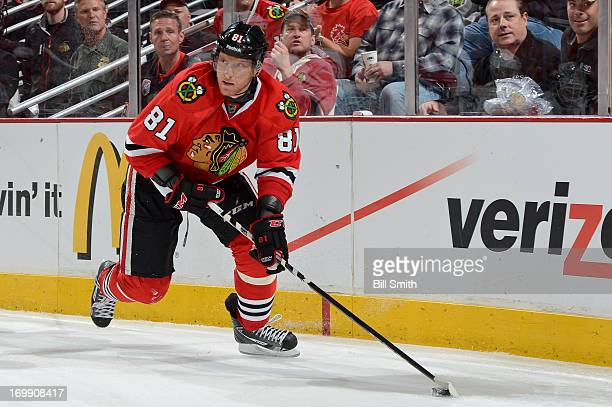 Marian Hossa of the Chicago Blackhawks skates with the puck in Game Two of the Western Conference Final against the Los Angeles Kings during the 2013...