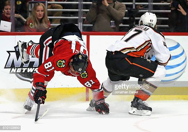 Marian Hossa of the Chicago Blackhawks suffering an injury after this collison with Hampus Lindholm of the Anaheim Ducks in the second period at the...